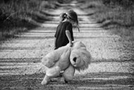 Sad girl with teddy bear